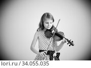 Купить «Portrait of girl with string and playing violin.», фото № 34055035, снято 15 мая 2016 г. (c) Nataliia Zhekova / Фотобанк Лори