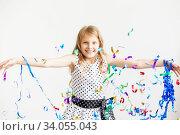 Купить «Little girl jumping and having fun celebrating birthday.», фото № 34055043, снято 15 мая 2016 г. (c) Nataliia Zhekova / Фотобанк Лори