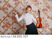 Купить «Beautiful gifted little girl playing on violin against the background of wallpaper with floral patterns», фото № 34055107, снято 12 декабря 2015 г. (c) Nataliia Zhekova / Фотобанк Лори