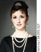 Купить «The girl in the image of Audrey Hepburn», фото № 34055327, снято 28 апреля 2014 г. (c) Nataliia Zhekova / Фотобанк Лори