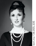 Купить «The girl in the image of Audrey Hepburn», фото № 34055335, снято 28 апреля 2014 г. (c) Nataliia Zhekova / Фотобанк Лори