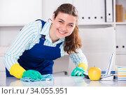 Woman in uniform is cleaning dust from the desk. Стоковое фото, фотограф Яков Филимонов / Фотобанк Лори
