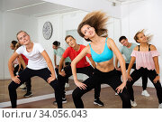 Купить «Teens practicing dance with female trainer», фото № 34056043, снято 7 июля 2020 г. (c) Яков Филимонов / Фотобанк Лори