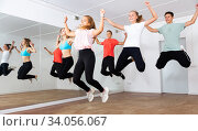 Happy teens jumping in choreography class. Стоковое фото, фотограф Яков Филимонов / Фотобанк Лори