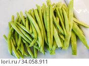 Купить «A pile of string beans ready for cooking.», фото № 34058911, снято 30 мая 2020 г. (c) age Fotostock / Фотобанк Лори