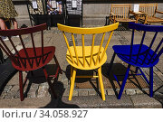 Купить «Aalborg, Denmark Brightly painted chairs for sale on Nytorv street at an antique shop.», фото № 34058927, снято 3 июня 2020 г. (c) age Fotostock / Фотобанк Лори