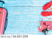 Купить «Red Summer background with camera starfish sandle sunglasses and luggage on blue wooden table background with copy space», фото № 34061099, снято 3 июля 2020 г. (c) easy Fotostock / Фотобанк Лори