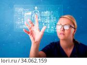 Купить «Doctor touching blue screen with full body analyze concept», фото № 34062159, снято 7 июля 2020 г. (c) easy Fotostock / Фотобанк Лори