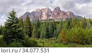 Купить «Panoramic image of Castle Mountain under cloudy sky, Bow Valley Parkway, Banff National Park, Alberta, Canada», фото № 34077531, снято 11 июля 2020 г. (c) easy Fotostock / Фотобанк Лори