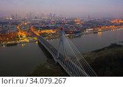 Warsaw with Swietokrzyski Bridge at twilight. Стоковое фото, фотограф Яков Филимонов / Фотобанк Лори