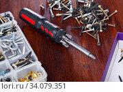 Tool box and set of screws and screwdriver. Стоковое фото, фотограф Яков Филимонов / Фотобанк Лори