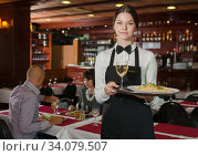 Smiling waitress with serving tray. Стоковое фото, фотограф Яков Филимонов / Фотобанк Лори