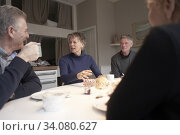 Senior friends eating breakfast together in holiday apartment. Стоковое фото, фотограф Egerland Productions / age Fotostock / Фотобанк Лори