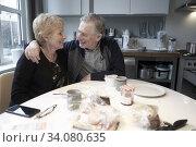 Senior couple at breakfast table. Стоковое фото, фотограф Egerland Productions / age Fotostock / Фотобанк Лори