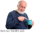Neutral elderly white haired man with blue cup of tea or coffe isolated on white. Стоковое фото, фотограф Zoonar.com/Serghei Starus / easy Fotostock / Фотобанк Лори