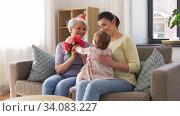 Купить «mother and daughter giving grandmother flowers», видеоролик № 34083227, снято 2 июня 2020 г. (c) Syda Productions / Фотобанк Лори