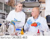 Купить «Scientists taking notes while checking agricultural products», фото № 34083463, снято 24 января 2019 г. (c) Яков Филимонов / Фотобанк Лори