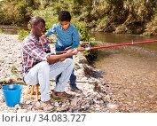 Купить «Man and his son fishing», фото № 34083727, снято 26 мая 2019 г. (c) Яков Филимонов / Фотобанк Лори