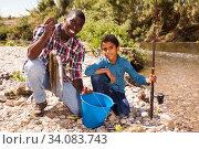 Man and boy with fish catch. Стоковое фото, фотограф Яков Филимонов / Фотобанк Лори