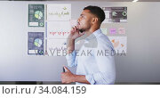 Купить «Professional businessman holding marker pen talking on the phone in modern office in slow motion», видеоролик № 34084159, снято 18 января 2020 г. (c) Wavebreak Media / Фотобанк Лори
