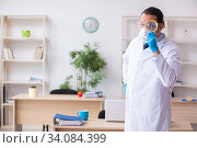 Купить «Young male doctor virologist in the office», фото № 34084399, снято 31 марта 2020 г. (c) Elnur / Фотобанк Лори