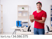 Купить «Young male courier delivering postbox to the office», фото № 34086075, снято 19 ноября 2019 г. (c) Elnur / Фотобанк Лори