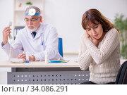 Young woman visiting old male doctor otorhinolaryngologist. Стоковое фото, фотограф Elnur / Фотобанк Лори