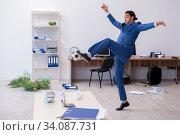 Купить «Young male employee playing football in the office», фото № 34087731, снято 13 сентября 2019 г. (c) Elnur / Фотобанк Лори