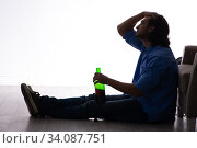 Young man suffering from alcoholism. Стоковое фото, фотограф Elnur / Фотобанк Лори