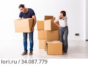 Купить «Young pair and many boxes in divorce settlement concept», фото № 34087779, снято 3 сентября 2019 г. (c) Elnur / Фотобанк Лори