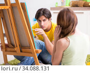 Купить «Young couple enjoying painting at home», фото № 34088131, снято 11 июля 2018 г. (c) Elnur / Фотобанк Лори