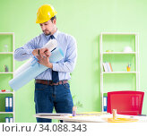 Young male architect working at the project. Стоковое фото, фотограф Elnur / Фотобанк Лори