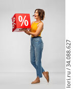happy smiling young woman with sale sign. Стоковое фото, фотограф Syda Productions / Фотобанк Лори