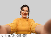 smiling woman with pierced nose taking selfie. Стоковое фото, фотограф Syda Productions / Фотобанк Лори