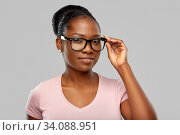 Купить «african american woman in glasses», фото № 34088951, снято 26 января 2020 г. (c) Syda Productions / Фотобанк Лори