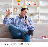 Купить «Funny man singing songs in karaoke at home», фото № 34089239, снято 29 марта 2017 г. (c) Elnur / Фотобанк Лори