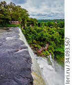 Купить «Travel to Argentina. The fantastic roaring Iguazu Falls. Picturesque basaltic ledges form the famous waterfalls. The concept of active and exotic tourism», фото № 34093567, снято 2 июля 2020 г. (c) easy Fotostock / Фотобанк Лори
