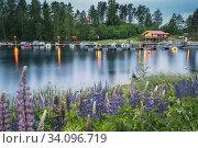 Купить «Sweden. Beautiful Red Swedish Wooden Log Cabin House And Pier Near Lake In Summer Evening Night. Lake Or River Landscape.», фото № 34096719, снято 11 июня 2019 г. (c) easy Fotostock / Фотобанк Лори