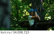 Купить «Rope adventure - smiling blonde woman sliding down on the rope using her insurance belt», видеоролик № 34098723, снято 6 июля 2020 г. (c) Константин Шишкин / Фотобанк Лори