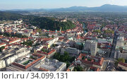 Купить «Panoramic aerial view of Ljubljana cityscape with buildings and streets, Slovenia», видеоролик № 34099131, снято 4 сентября 2019 г. (c) Яков Филимонов / Фотобанк Лори