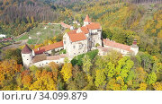 Купить «Fall view from drone of medieval Pernstejn Castle, Czech Republic», видеоролик № 34099879, снято 15 октября 2019 г. (c) Яков Филимонов / Фотобанк Лори