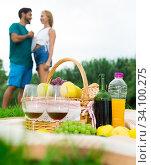 Купить «Picture of picnic basket on the grass for couple», фото № 34100275, снято 10 августа 2017 г. (c) Яков Филимонов / Фотобанк Лори