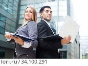 Two office workers are posing with laptop and folder. Стоковое фото, фотограф Яков Филимонов / Фотобанк Лори