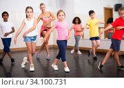 Купить «Boys and girls training in dance studio», фото № 34100731, снято 15 июля 2020 г. (c) Яков Филимонов / Фотобанк Лори