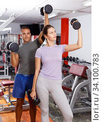 Sporty guy and girl posing with dumbbells. Стоковое фото, фотограф Яков Филимонов / Фотобанк Лори