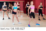 Young sporting women performing modern dance in fitness studio. Стоковое фото, фотограф Яков Филимонов / Фотобанк Лори