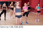 Young attractive girls performing modern dance in fitness studio. Стоковое фото, фотограф Яков Филимонов / Фотобанк Лори