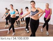 Купить «Ordinary active females exercising dance moves», фото № 34100839, снято 21 сентября 2019 г. (c) Яков Филимонов / Фотобанк Лори
