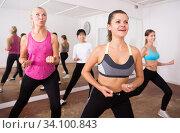Купить «Ordinary active females exercising dance moves», фото № 34100843, снято 21 сентября 2019 г. (c) Яков Филимонов / Фотобанк Лори