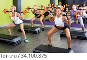 Portrait of sporty women exercising with barbell in fitness club. Стоковое фото, фотограф Яков Филимонов / Фотобанк Лори
